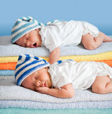 Two sleeping babies. Lying on towel stack Royalty Free Stock Photography