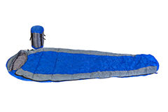 Two of the sleeping bags in a compression bags and unpacked. Stock Image
