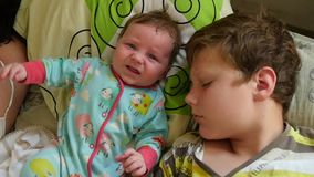 Two Sleeping Brothet Kids. Slow motion shot of a two cute small brothers sleeping on bed stock video footage