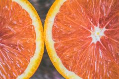 Two Sliced Citrus Fruits Royalty Free Stock Images