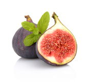 Two Sliced Figs With Mint Isolated On White Background Royalty Free Stock Images