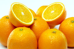 Two Sliced Juicy Oranges Among Group Of Oranges Royalty Free Stock Images
