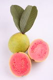 Two Sliced Pink Guava fruit with leaf. Stock Image