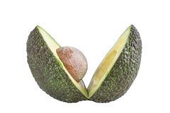 Two slices of avocado isolated Cut in v profile view one with core Royalty Free Stock Photography