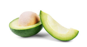Two slices of avocado isolated on a white background. One slice Stock Photo