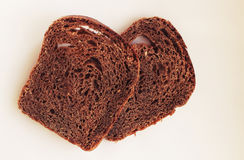 Two slices of black bread. Rye bread on white background Stock Image