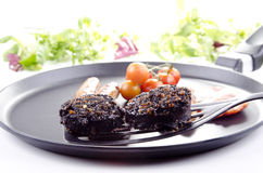 Two slices of black pudding Stock Photo