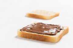 Two slices of bread with chocolate hazelnut spread Royalty Free Stock Photo