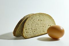 Two slices of bread and egg Royalty Free Stock Image