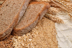 Two slices of bread with fresh ears wheat, dry beans of wheat, f Royalty Free Stock Photography