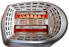 Two slices of bread toasting in metal toaster Royalty Free Stock Photos