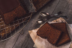 Two slices of chocolate cake. Served on a wooden table Stock Image