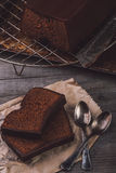 Two slices of chocolate cake. Served on a wooden table Royalty Free Stock Images