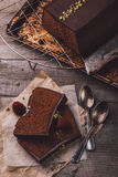 Two slices of chocolate cake. Served on a wooden table Stock Photo
