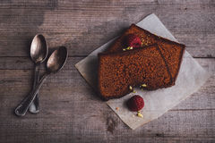 Two slices of chocolate cake. Served on a wooden table Stock Photos