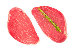 Two slices of fresh beef meat. Two slices of fresh raw beef meat for steaks. Top view, isolated on white background Stock Images