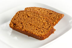 Two slices of freshly baked pumpkin bread. On white isolating background Stock Photo