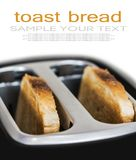 slices of fried toast sticking out of a black toaster Royalty Free Stock Photo