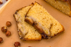 Two slices of homemade banana cake with hazelnuts. Close up top view Royalty Free Stock Photos