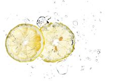 Two slices of lemon in a water splash isolated Royalty Free Stock Photo