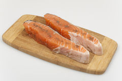 Two slices of marinated salmon. Prepared for frying closeup Stock Photography
