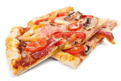 Two slices of meat and vegetables pizza Stock Image
