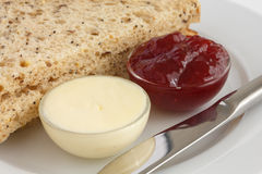 Two slices of multigrain bread with jam and butter Royalty Free Stock Image