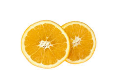 Two slices of orange. Closeup studio photo of  orange slices  nice and juicy isolated in the middle of white background Royalty Free Stock Photo