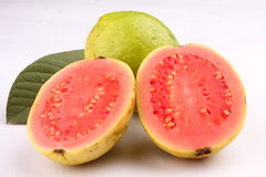 Two  slices of Pink Guava fruit with leaf. Stock Photo
