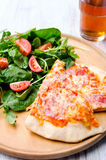 Two slices of pizza with side salad Stock Photos