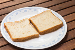 Two slices of plain wholemeal bread on plate Stock Photo