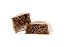 Two slices of porous chocolate close-up texture isolated on a white Stock Photo