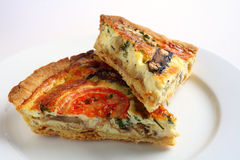 Two slices of quiche Stock Photography