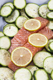 Two slices of raw salmon with lemon and zucchini Royalty Free Stock Image