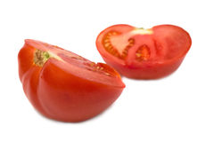 Two slices of ripe tomato Stock Images