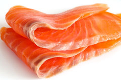 Two slices of salmon on a white. Close up Stock Photography