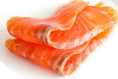 Two slices of salmon on a white. Close up Royalty Free Stock Photos