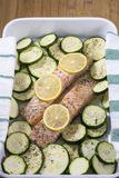 Two slices of stewed salmon with lemon and zucchini Stock Images