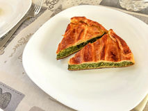 Two slices of a tasty savory rustic pie. Made with spinach and ricotta cheese Royalty Free Stock Images