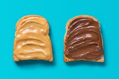 Two slices of toast with peanut butter and chocolate royalty free stock images