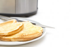 Two slices of toast with toaster Royalty Free Stock Photos