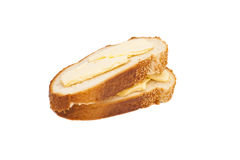 Two slices of wheaten bread spreaded with butter Royalty Free Stock Photo