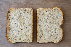 Two slices of whole grain bread Stock Photos