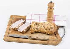 Two slices of whole grain bread with ham and knife Stock Images
