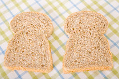 Two slices of wholemeal bread placed on cloth Royalty Free Stock Photo