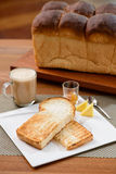 Two slide of toast and a loaf of bread Stock Photos