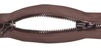 Two sliders on metallic brown zip fastener Stock Photography
