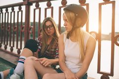 Two slim and sexy young women and roller skates. One female has an inline skates and the other has a quad skates. Girls Stock Photos