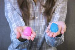Two slimes pink and blue in woman`s hands. Playing with slime. royalty free stock images