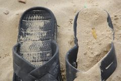 Two Slippers in the sand half in the frame royalty free stock photos